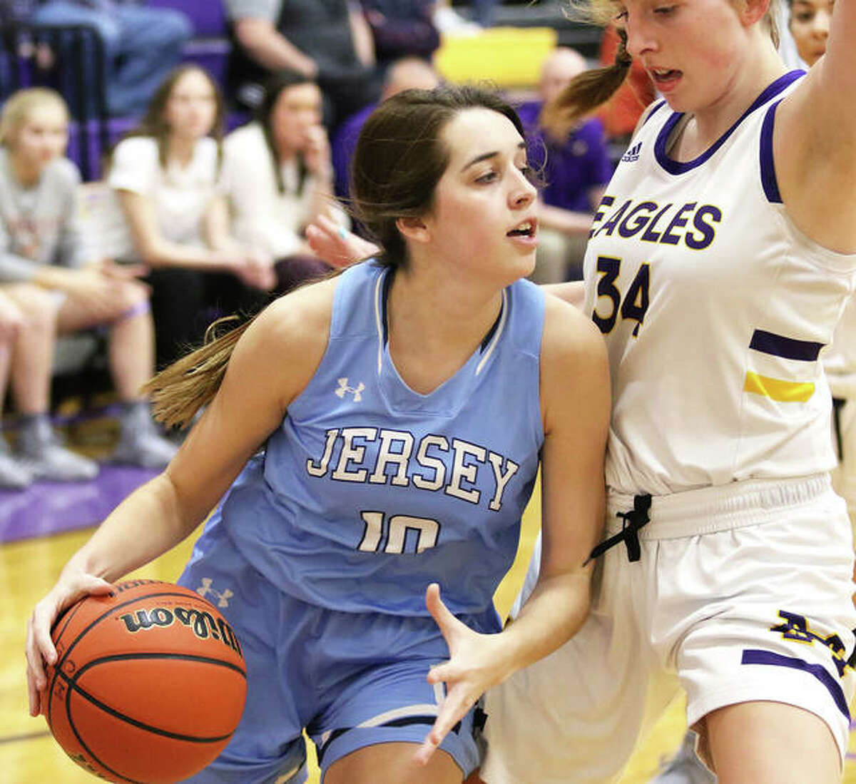 Jersey's Abby Manns (left) drives on CM's Jackie Woelfel in the first half Tuesday at Bethalto.