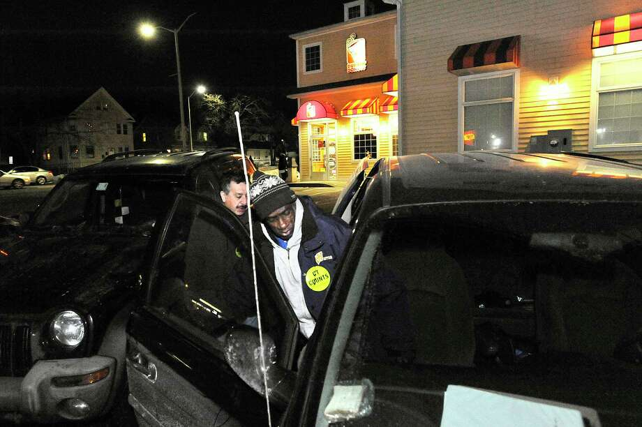 Volunteers Sidney Elmore, right, and Ricardo Osorio get back into their car after canvassing the Dunkin' Donuts on East Main Street for homeless people during the point-in-time homeless count in Stamford, Conn., on Wednesday, Feb. 18, 2015. According to Connecticut Coalition to End Homelessness, in Stamford and Greenwich homelessness increased 45 percent in 2013. The final numbers for Wednesday's count will not be immediately available. Photo: Jason Rearick / Jason Rearick / Stamford Advocate