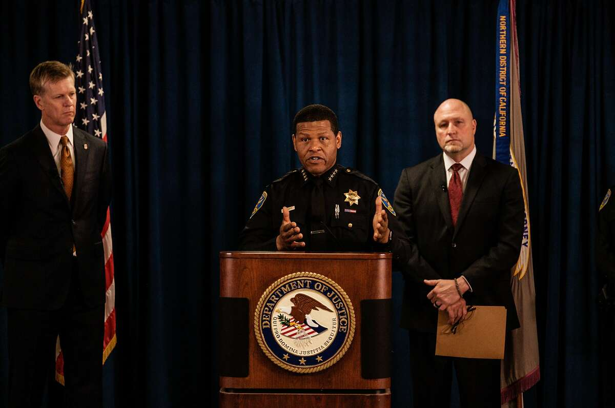 San Francisco Police chief William Scott, center speaks at a press conference in San Francisco, Calif. on Thursday, January 9, 2020. He was flanked by U.S. Attorney David Anderson, left, and John F. Bennett, special agent in charge of the FBI's San Francisco field office. During the press conference it was revealed that two alleged gang members were charged with multiple counts of using a firearm in a violent crime resulting in death and ex-felons being in possession of a firearm. Because of gang enhancements, the men could face the death penalty if convicted.