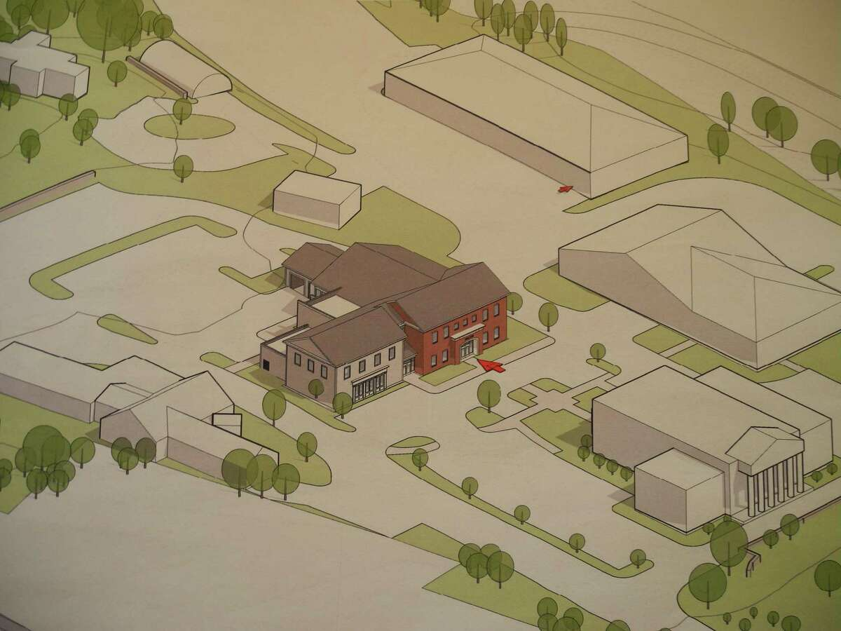 An aerial view shows where a new police station would be situated on the town hall campus. The committee is considering moving the site to the end of the main driveway, which would require demolishing the annex. Such a move would improve parking and traffic circulation on the campus.