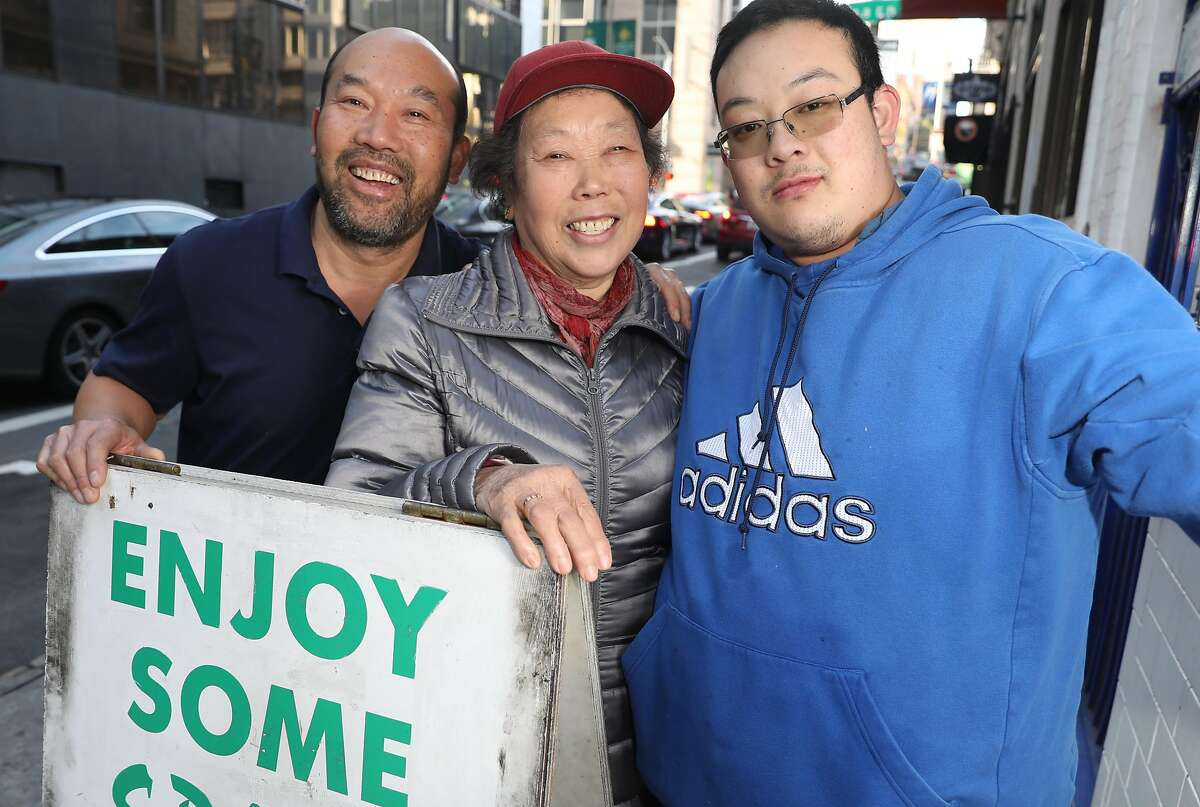 Henry�s Hunan Meng Tao Zhong (middle) flanked by her son Eddy Zhu (left) and her grandson Jin Zhu (right) seen in front of the restaurant on Sacramento St. on Tuesday, Jan. 7, 2020, in San Francisco, Calif.