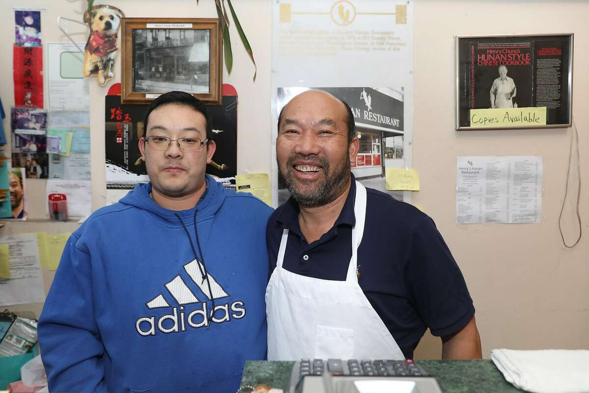Jin Zhu (left) with his dad Eddy Zhu (right) at the desk entrance of Henry�s Hunan on Sacramento St. seen on Tuesday, Jan. 7, 2020, in San Francisco, Calif.