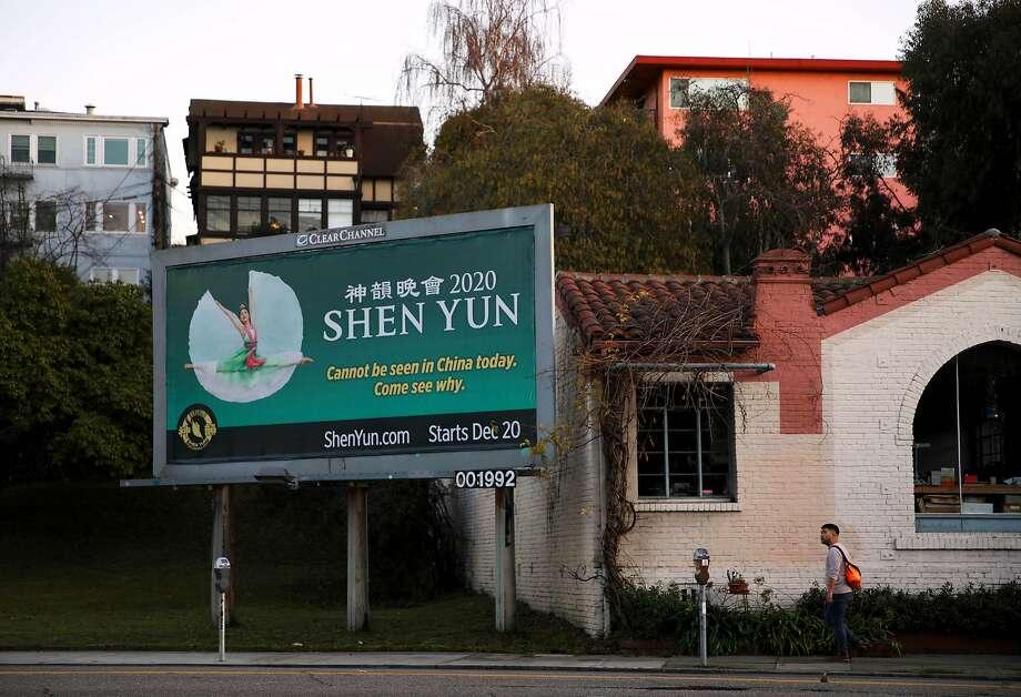 A man walks near a Shen Yun billboard as he approaches Park Blvd. and East 20th Street, in Oakland, Calif., on Tuesday, January 7, 2020. Photo: Yalonda M. James / The Chronicle