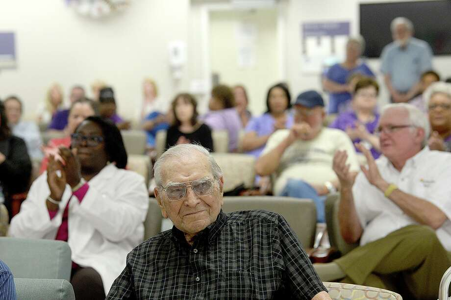 "WWII veteran and former Port Neches Mayor Thomas ""T.J."" Sasser was surrounded by family, friends and caregivers with the Veterans Administration as they celebrated his 100th birthday at the Beaumont VA Outpatient Clinic Thursday, May 24. Photo taken Thursday, May 24, 2018 Kim Brent/The Enterprise Photo: Kim Brent / The Enterprise / BEN"