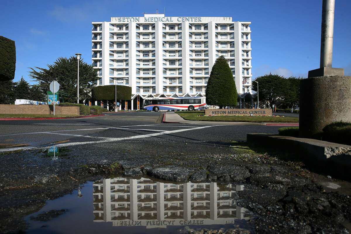 Seton Medical Center and it's reflection in a puddle is seen on Thursday, January 9, 2020 in Daly City, Calif. Seton Medical Center a hospital that is the largest employer in Daly City and serves mostly low-income patients, seniors and a large Filipino population, is facing an uncertain future after the company that was closing a deal to buy the hospital from its current bankrupt owner Verity Health backed out of the deal.