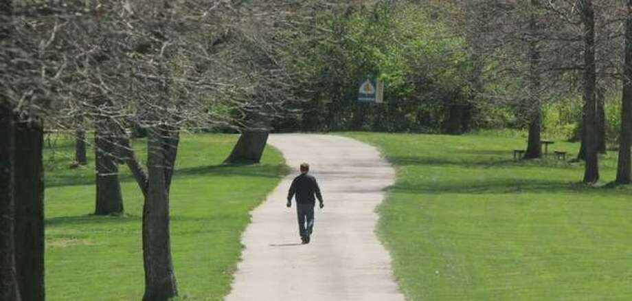 A hiker makes his way down the trail at LaVista Park in Godfrey.