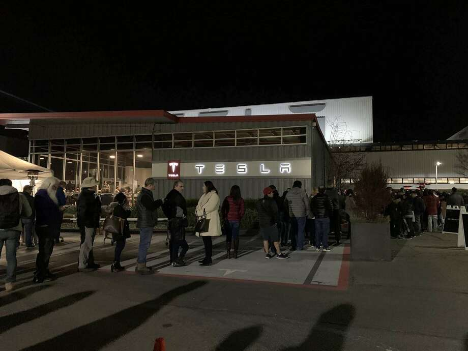 Tesla customers lined up at the company's plant in Fremont on New Year's Eve. Photo: Ellen Fader