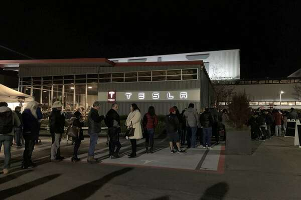 Tesla customers lined up at the company's plant in Fremont, Calif. on New Year's Eve, hoping to take delivery of a car before a federal tax credit on Tesla electric vehicles expired at the end of 2019.