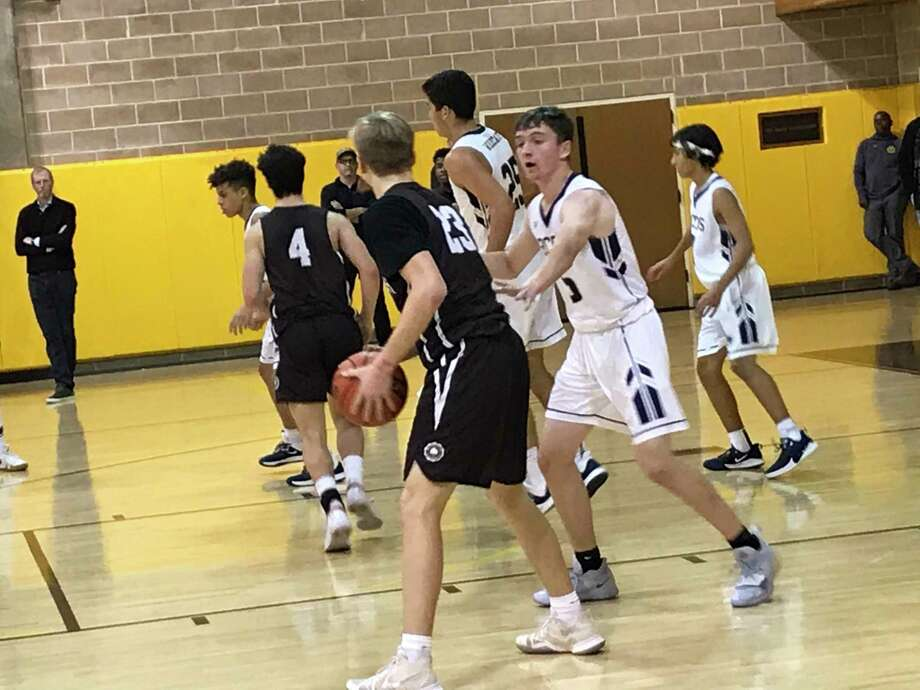 Brunswick School forward Colin Mulshine looks to pass the ball during the Bruins' game against visiting Rye Country Day School on Thursday, Jan. 9, 2020. Mulshine scored 13 points in the Bruins' 61-55 win. Photo: /