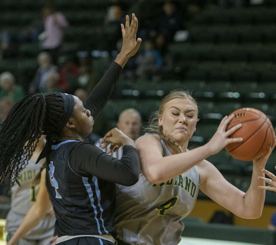Midland College's Makayla Escue tries to get around Odessa College's Okako Adika for a shot 01/09/20 at the Chaparral Center. Tim Fischer/Reporter-Telegram Photo: Tim Fischer/Midland Reporter-Telegram