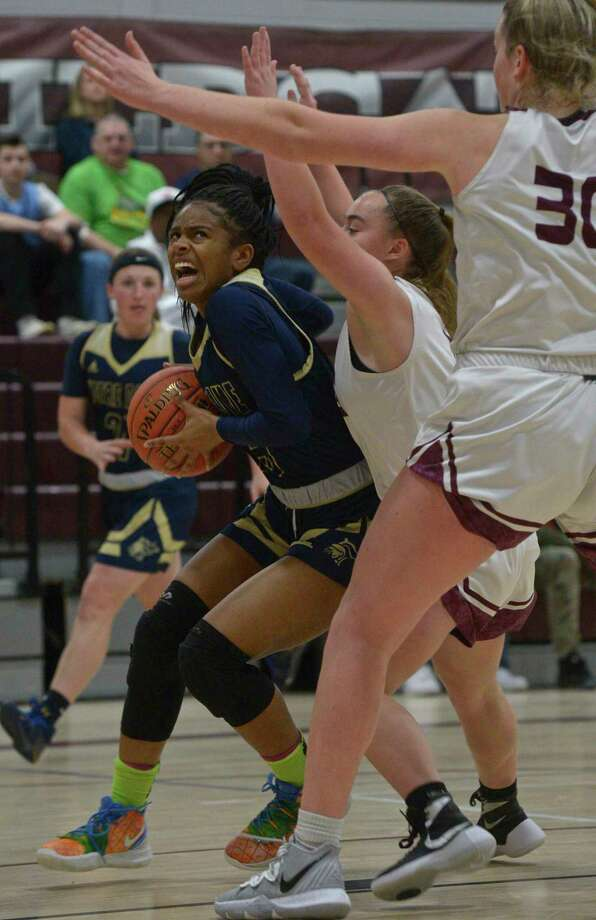 Notre Dame-Fairfield's Ciara Brown drives to the basket while being defended by Bethel's Mia Prazeres (1) and Maranda Nyborg (30) on Thursday. Photo: H John Voorhees III / Hearst Connecticut Media / The News-Times