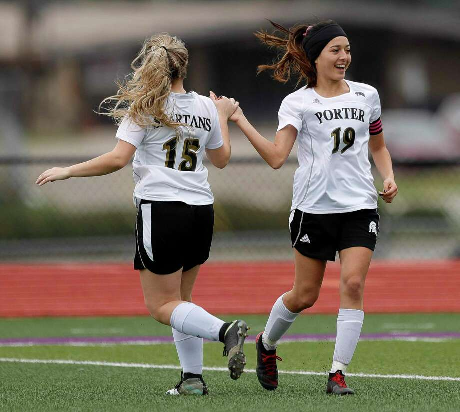 Porter midfielder Denise Gomez(19) gets a high-five from midfielder Atliy Klodziejski (15) after scoring a goal in the first period of a match during the Kat Cup soccer tournament at Berton A. Yates Stadium, Thursday, Jan. 9, 2020, in Willis. Photo: Jason Fochtman, Houston Chronicle / Staff Photographer / Houston Chronicle © 2020