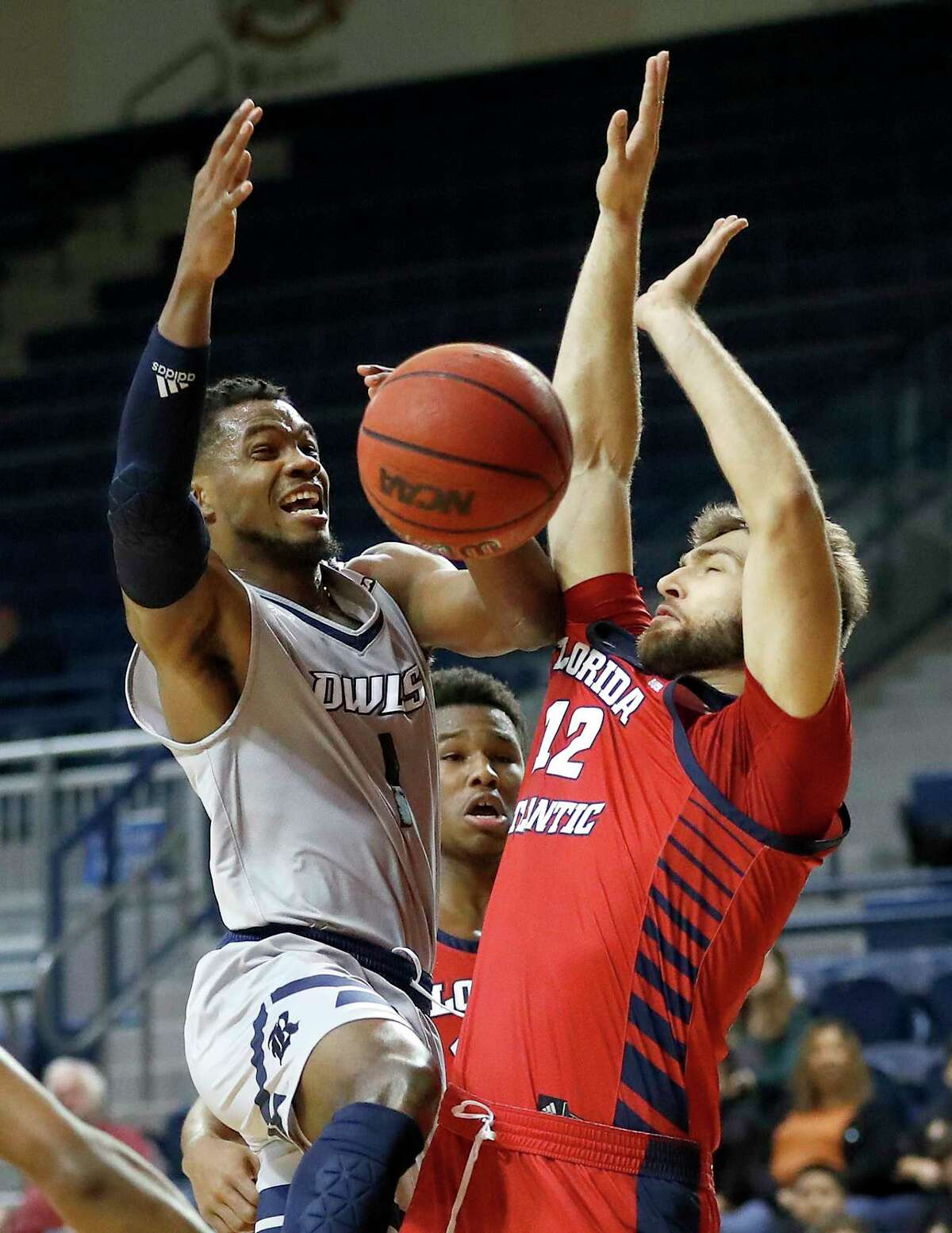 Rice Owls guard Josh Parrish (1) goes up for a basket against Florida Atlantic Owls forward Aleksandar Zecevic (12) during the first half of an NCAA men's college basketball game at Tudor Fieldhouse Thursday, Jan. 9, 2020, in Houston.
