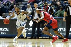 Rice Owls guard Ako Adams (3) works against Florida Atlantic Owls guard D.J. Robertson (4) during the first half of an NCAA men's college basketball game at Tudor Fieldhouse Thursday, Jan. 9, 2020, in Houston.