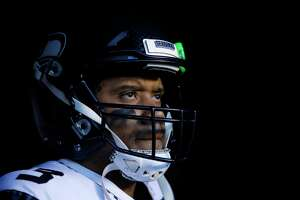 Seattle Seahawks' Russell Wilson waits to run onto the field before an NFL wild-card playoff football game against the Philadelphia Eagles, Sunday, Jan. 5, 2020, in Philadelphia.