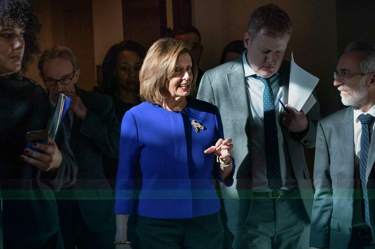 Speaker of the House Nancy Pelosi, D-Calif., walks to meet with reporters following escalation of tensions this week between the U.S. and Iran, Thursday, Jan. 9, 2020, on Capitol Hill in Washington. The House plans to vote on a measure limiting President Donald Trump's ability to take military action against Iran as Democratic criticism of the U.S. killing of a top Iranian general intensified. (AP Photo/J. Scott Applewhite)