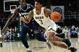 Siena's Manny Camper drives to the basket against Saint Peter's Fousseyni Drame during a game at the Times Union Center on Thursday, Jan. 9, 2020 in Albany, N.Y. (Lori Van Buren/Times Union)