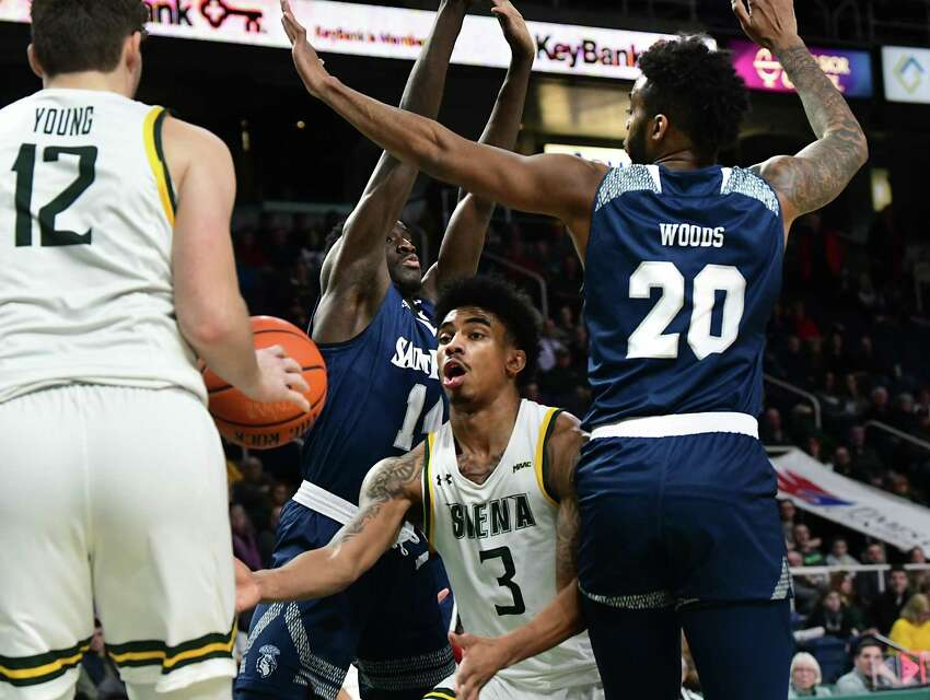 Siena's Manny Camper shuffles the ball over to Kyle Young under the basket during a game against Saint Peter's at the Times Union Center on Thursday, Jan. 9, 2020 in Albany, N.Y. (Lori Van Buren/Times Union)