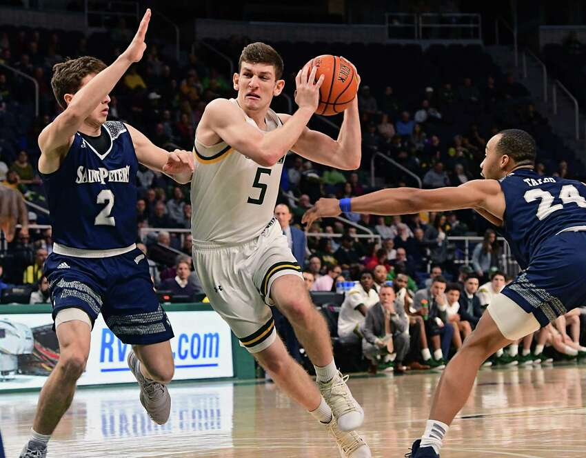 Siena's Matt Hein drives to the basket against Saint Peter's Doug Edert during a game at the Times Union Center on Thursday, Jan. 9, 2020 in Albany, N.Y. (Lori Van Buren/Times Union)