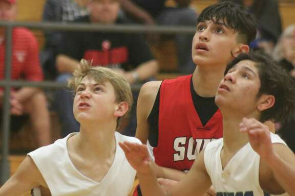 The Fairmont Junior High duo of Landon Baker (left) and Tre Martinez box out a Pearland South player as the three wait to see if they need to rebound a free-throw attempt late in the fourth period.