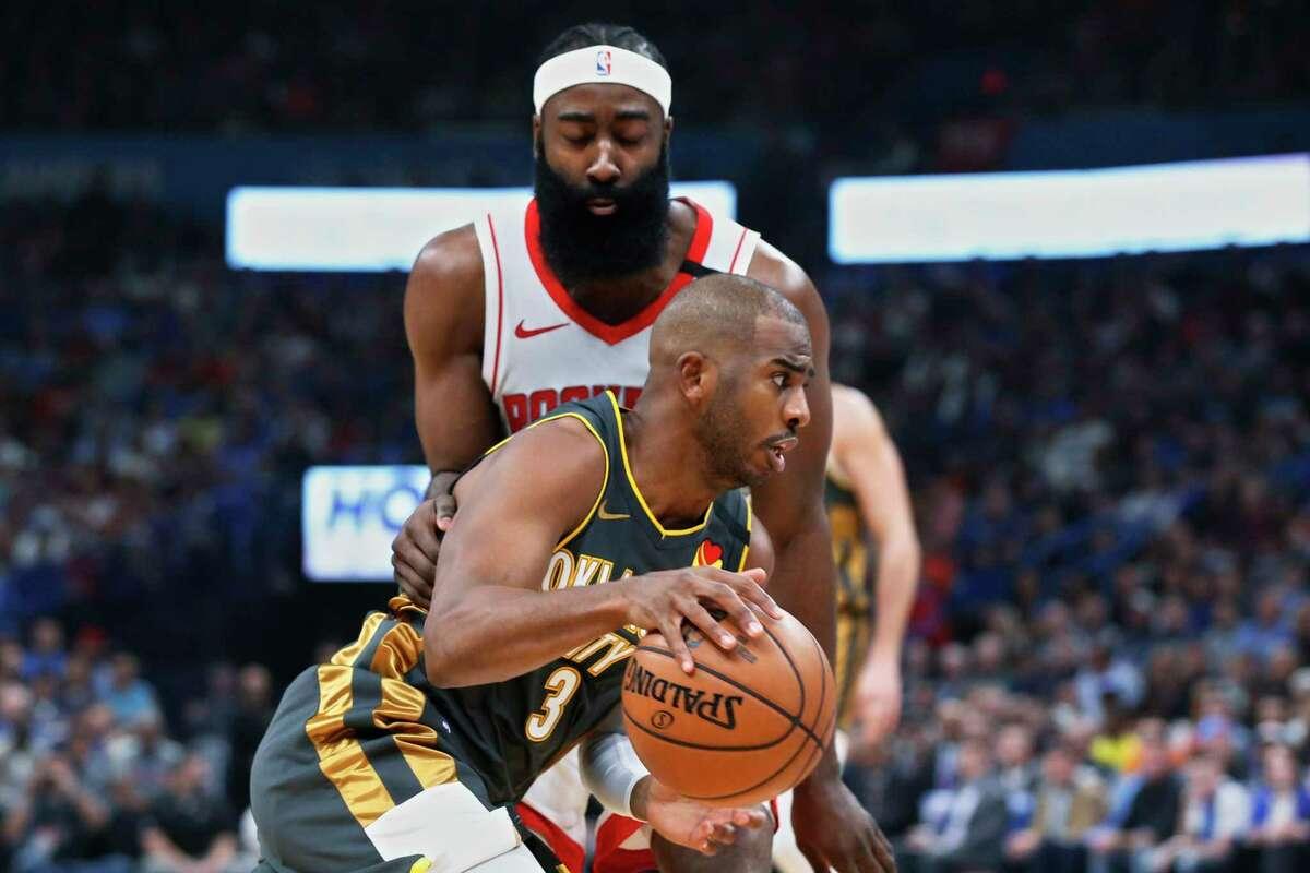 Oklahoma City Thunder guard Chris Paul (3) drives past Houston Rockets guard James Harden during the first half of an NBA basketball game Thursday, Jan. 9, 2020, in Oklahoma City. (AP Photo/Sue Ogrocki)