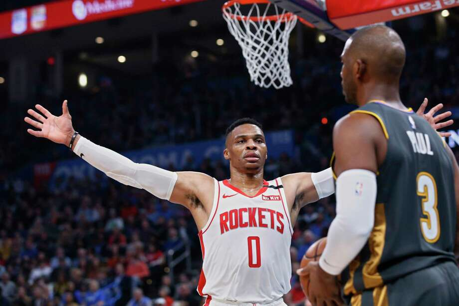 Houston Rockets guard Russell Westbrook (0) defends as Oklahoma City Thunder guard Chris Paul (3) looks to inbound the ball during the ball during the first half of an NBA basketball game Thursday, Jan. 9, 2020, in Oklahoma City. (AP Photo/Sue Ogrocki) Photo: Sue Ogrocki, Associated Press / Copyright 2020 The Associated Press. All rights reserved.