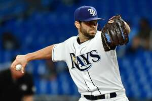 ST. PETERSBURG, FLORIDA - SEPTEMBER 05: Austin Pruitt #45 of the Tampa Bay Rays pitches to the Toronto Blue Jays in the first inning of a baseball game at Tropicana Field on September 05, 2019 in St. Petersburg, Florida. (Photo by Julio Aguilar/Getty Images)