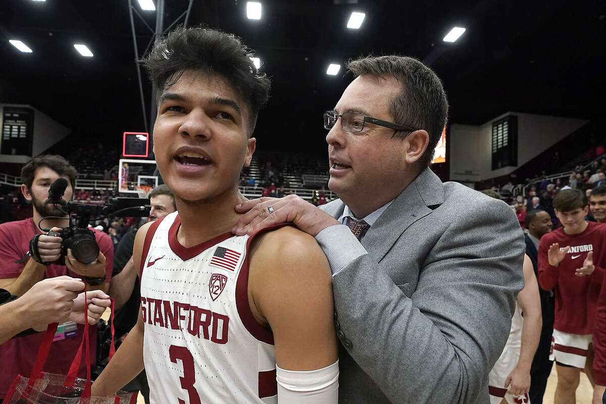 Stanford head coach Jerod Haase, right, celebrates with Stanford guard Tyrell Terry (3) after a 61-55 victory over Washington in an NCAA college basketball game Thursday, Jan. 9, 2020, in Stanford, Calif. (AP Photo/Tony Avelar)