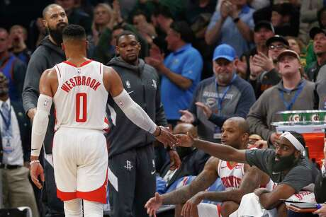 Houston Rockets guard Russell Westbrook (0) shakes hands with teammate James Harden, right, as he walks off the court in the second half of the team's NBA basketball game against the Oklahoma City Thunder on Thursday, Jan. 9, 2020, in Oklahoma City. (AP Photo/Sue Ogrocki)