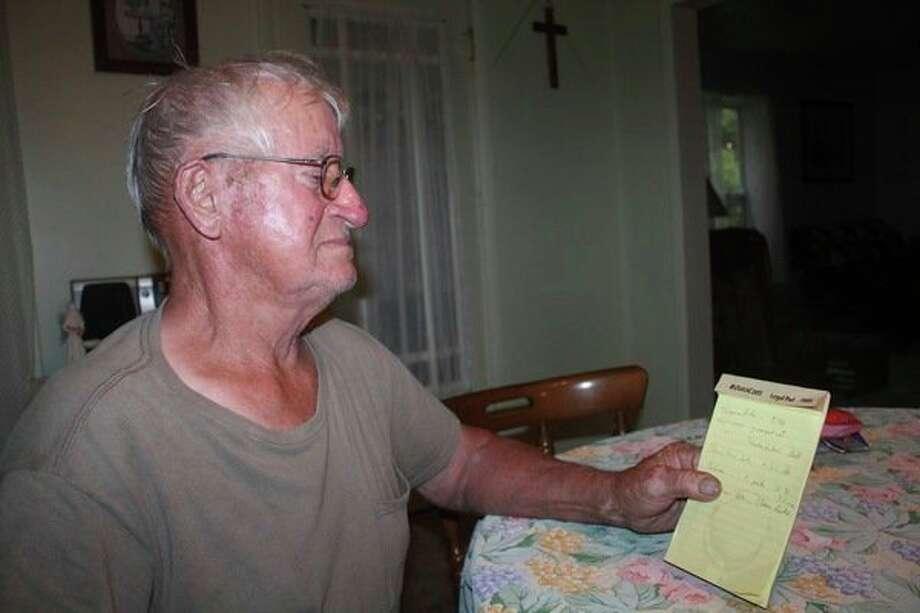 JerryMondrella reviews his ice fishing notes. (Pioneer file photo)