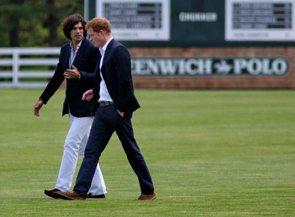 Britain's Prince Harry, right, walks with polo player Nacho Figueras before the Sentebale Royal Salute Polo Cup charity match in Greenwich, Conn., May 15, 2103.