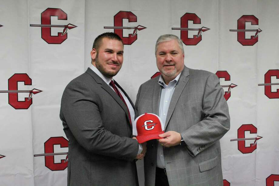New Cleveland AD/football coach Jason Fiacco (left) standing with Cleveland ISD superintendent Chris Trotter (right) Thursday night at a special board meeting. Photo: Marcus Gutierrez Staff Photo
