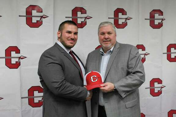 New Cleveland AD/football coach Jason Fiacco (left) standing with Cleveland ISD superintendent Chris Trotter (right) Thursday night at a special board meeting.
