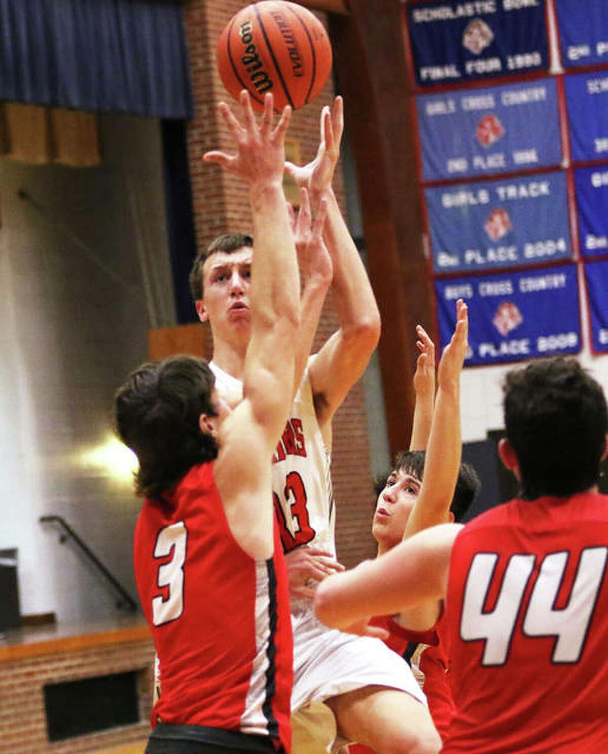 Calhoun's Corey Nelson, shown shooting over Staunton's Brent Kinder (3) during the title game at the Carlinville Holiday Tourney on Dec. 30, scored 15 points Thursday night in the Warriors' loss to unbeaten Payson Seymour in Hardin.