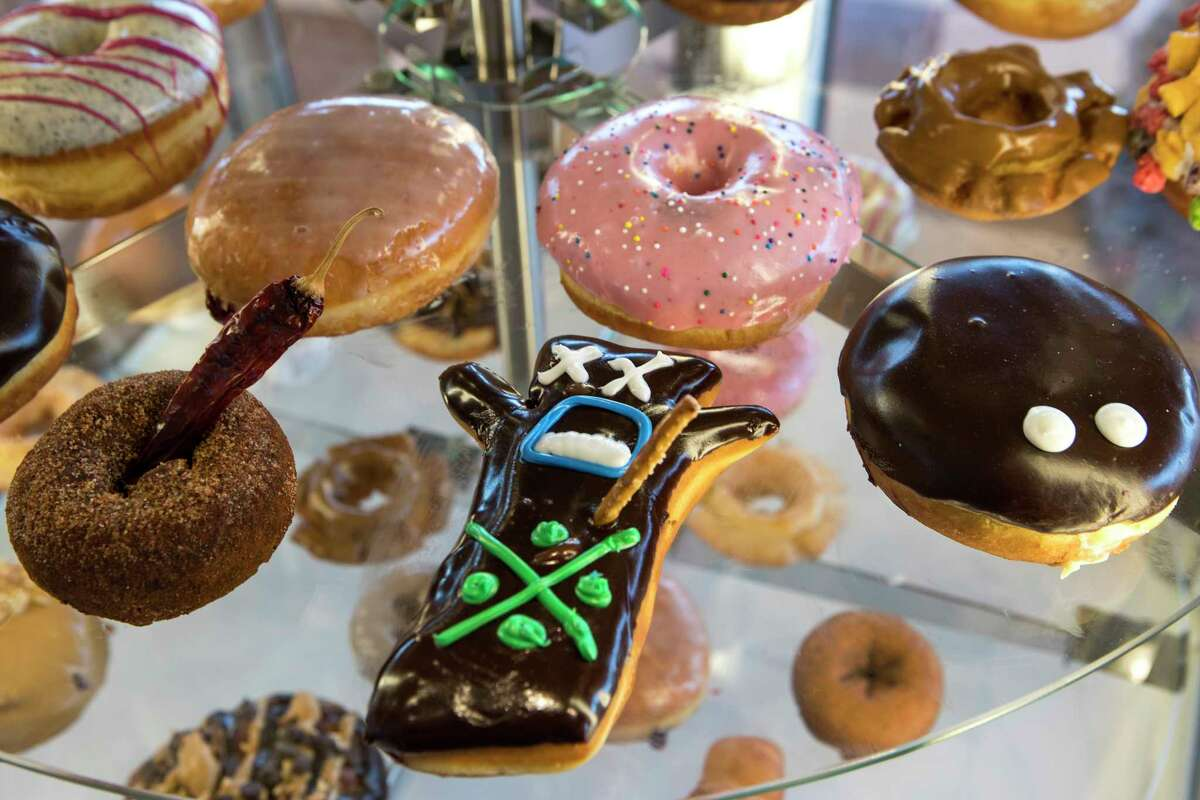 The signature voodoo doll doughnut is shown at Voodoo Doughnut on Tuesday, Jan. 7, 2020, in Houston.