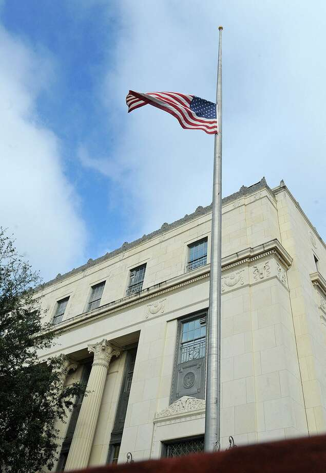 In the wake of former Congressman Jack Brook's death, the flags at the Jack Brooks Federal Courthouse are flown at half staff. The long term congressman passed away Tuesday night from a sudden illness. Photo taken Wednesday, December 05, 2012 Guiseppe Barranco/The Enterprise Photo: Guiseppe Barranco, STAFF PHOTOGRAPHER / Guiseppe Barranco/The Enterprise / The Beaumont Enterprise