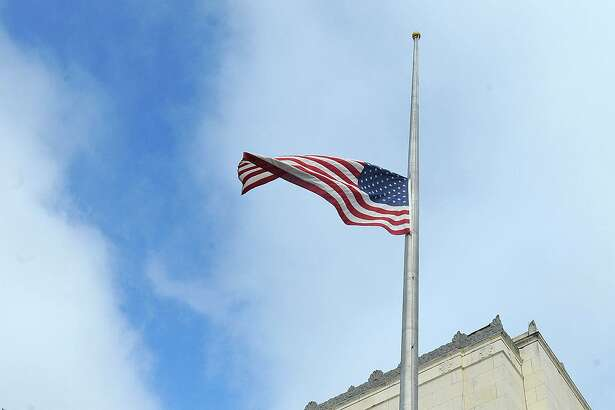 In the wake of former Congressman Jack Brook's death, the flags at the Jack Brooks Federal Courthouse are flown at half staff. The long term congressman passed away Tuesday night from a sudden illness. Photo taken Wednesday, December 05, 2012 Guiseppe Barranco/The Enterprise