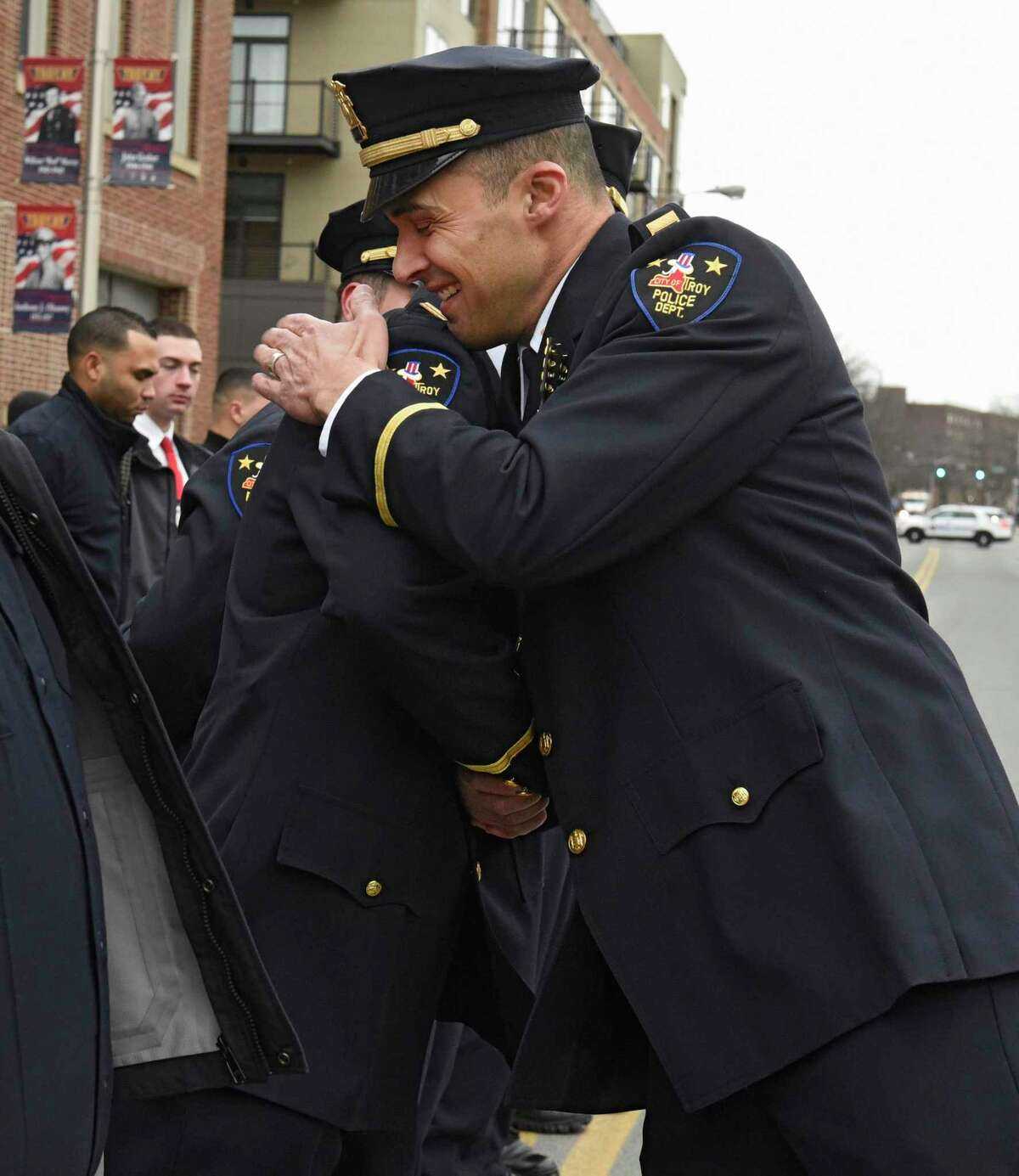 Officer Tom Bevevino hugs Detective Capt. Joseph Centanni, right, while Centanni says goodbye to his police family as he is honored with a walkout ceremony upon his retirement on Friday, Jan. 10, 2020 in Troy, N.Y. (Lori Van Buren/Times Union)