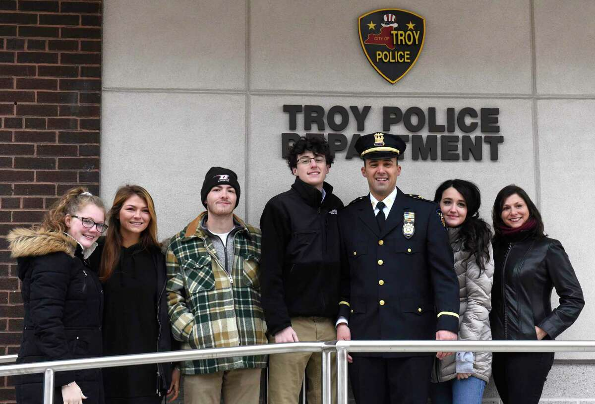 Detective Capt. Joseph Centanni stands with his family as he is honored with a walkout ceremony upon his retirement on Friday, Jan. 10, 2020 in Troy, N.Y. (Lori Van Buren/Times Union)