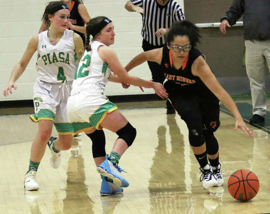 Gillespie's Shelby Taylor (right) dribbles past backcourt pressure from Southwestern's Hayley Rodgers (12) and Josie Bouillon (4) in a Dec. 5 game in Piasa. The Miners were back in SCC action Thursday night and Taylor scored 12 points in a Miners win at Vandalia. Photo: Greg Shashack / The Telegraph