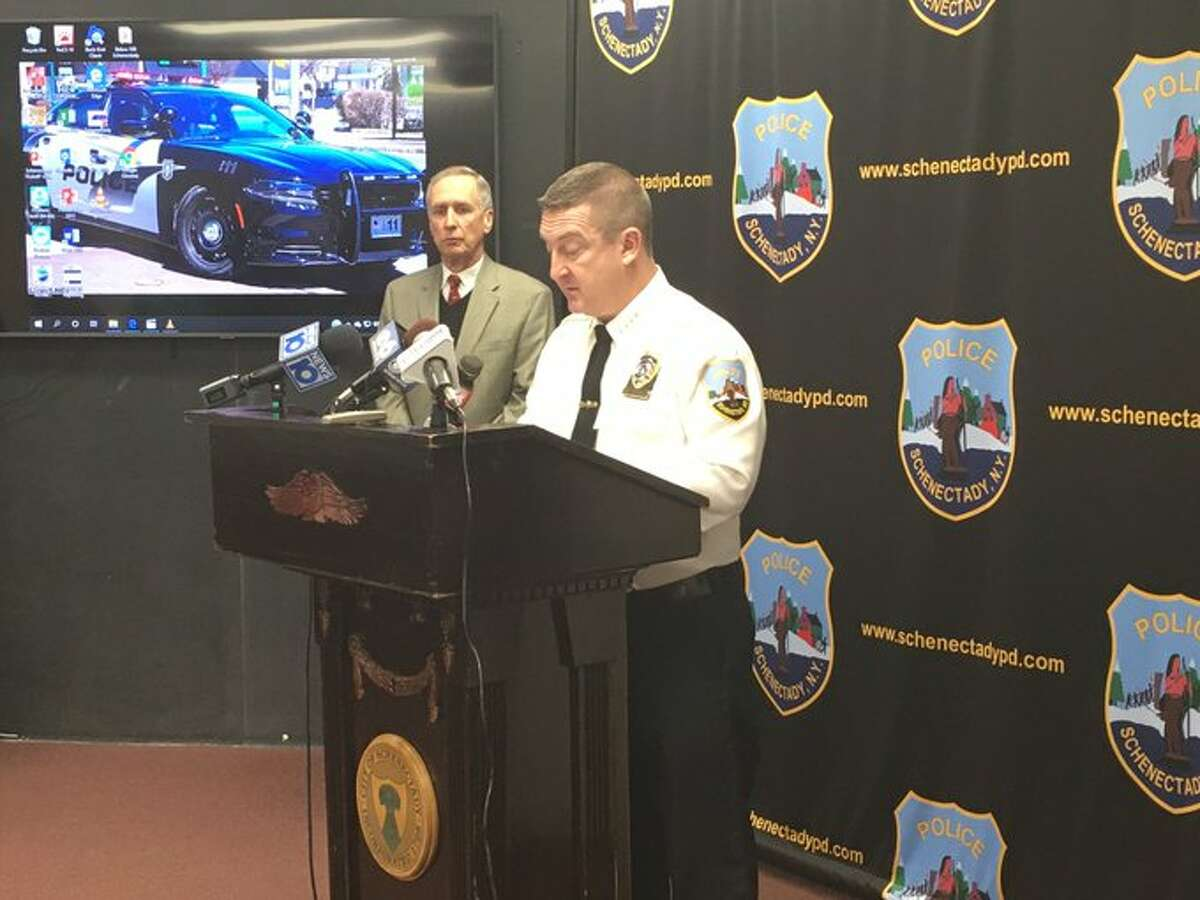 Police Chief Eric Clifford speaks Friday about a November shooting that involved one of the police department's sergeant. At left is Public Safety Commissioner Michael Eidens.