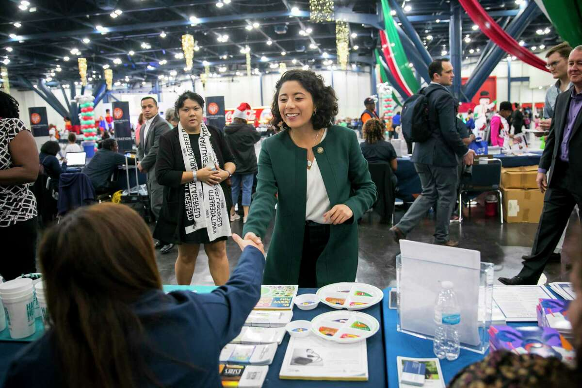 Judge Lina Hidalgo greets tables of volunteers during the 25th annual Toys for Kids event hosted by Congresswoman Sheila Jackson-Lee at the George R. Brown Convention Center in downtown Houston on Saturday, Dec. 14, 2019, in Houston.