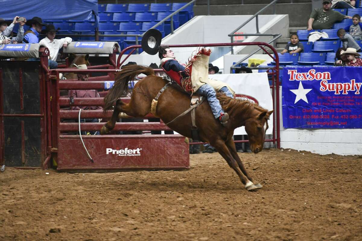 Paden Hurst from Huntsville, Texas competes in bareback bronc riding at the Sandhills Rodeo Thursday, Jan. 9, 2020 at the Ector County Coliseum. Jacy Lewis/Reporter-Telegram