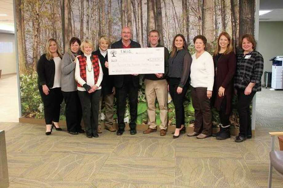 Receiving the check that will support TWIG's special projects at Spectrum Health Ludington Hospital in 2020 (from left) are Brandy Henderson Miller, Bobbie Severance-Roach, Mary Hoffman, T. J. Brand, Bob Budreau, Scott Smith, Kaley Petersen, Valerie Berrett, Tara Autrey and Debbie Nellis. (Photo provided by Spectrum Health)