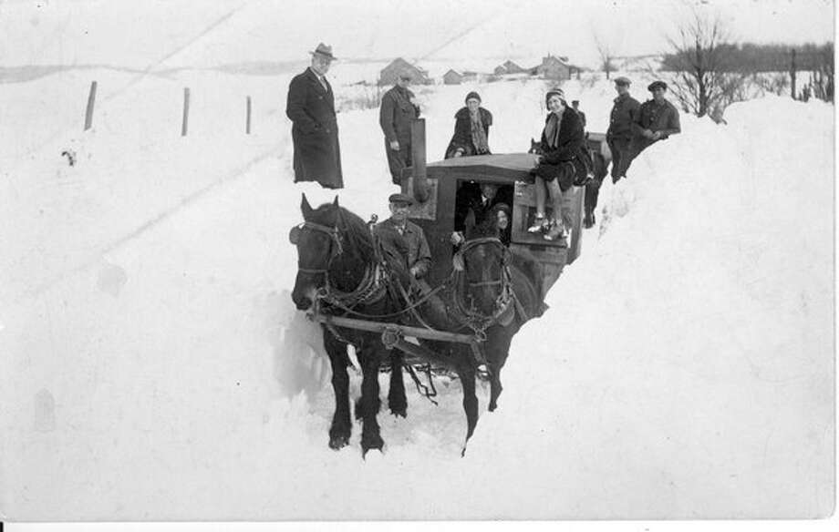 Wishing for our missing snow? Here are some folks trying to travel out Copemish way after a snowstorm in 1931. (Courtesy Photo/Griner family collection)