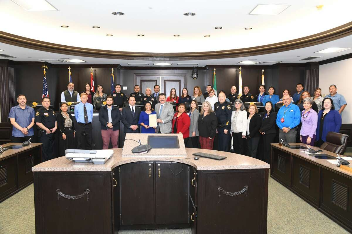 Attendees of the Human Trafficking Awareness Month Proclamation pose for a photo at City Hall, Thursday, Jan. 09, 2020.