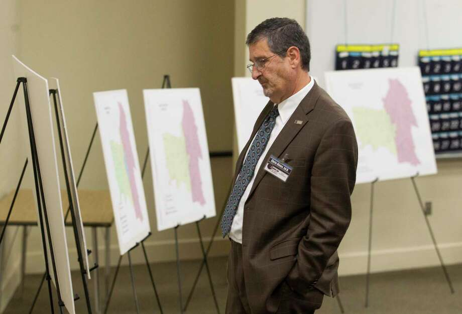 Conroe ISD Deputy Superintendent Chris Hines looks over zoning concepts as community members gather to give feedback on rezoning ideas for Stockton Junior High School back in November. Conroe ISD presented three different zoning scenarios for the new school scheduled to open in August 2020. Photo: Jason Fochtman, Houston Chronicle / Staff Photographer / Houston Chronicle