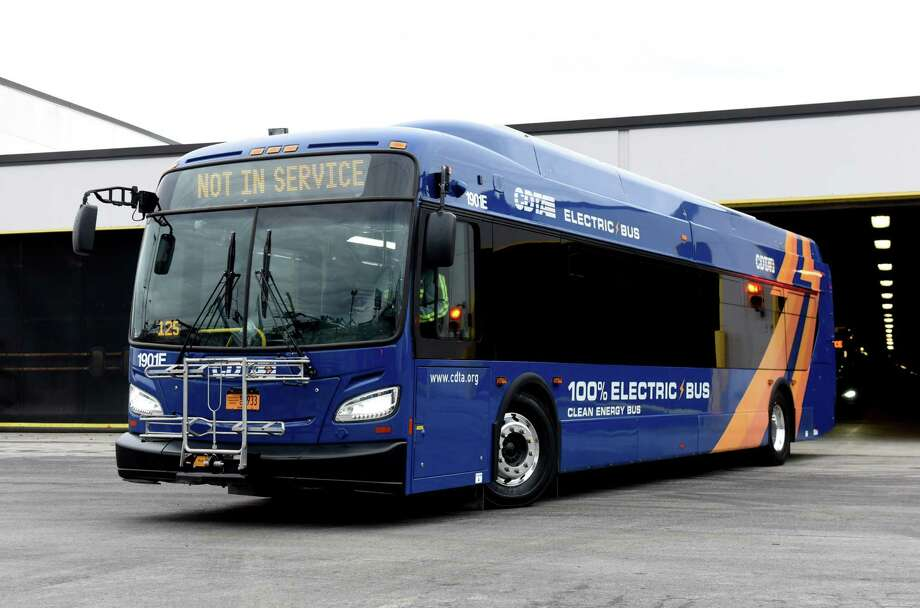 One of the Capital District Transportation Department's four new electric busses is driven out of the depot garage on Friday, Jan. 10, 2020, in Albany, N.Y. CDTA's implementation of the New Flyer Xcelsior CHARGE 40-foot buses are said to eliminate between 85 and 175 tons of greenhouse gas emissions annually, according to CDTA. (Will Waldron/Times Union) Photo: Will Waldron, Albany Times Union / 40048605A