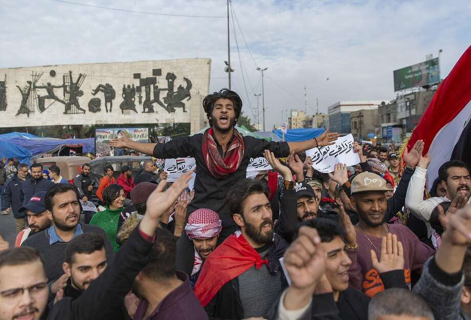 Protesters rally in Baghdad against both the Iraqi government and the presence of U.S. forces. Photo: Nasser Nasser / Associated Press