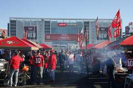 Fans tailgate at Levi's Stadium before an NFL football game between the San Francisco 49ers and the Atlanta Falcons in Santa Clara, Calif., Sunday, Dec. 15, 2019. (AP Photo/John Hefti)